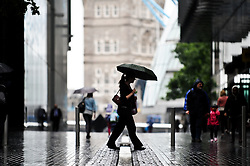 © Licensed to London News Pictures. 29/08/2012. London,UK. People with umbrellas walk along Southbank in the Rain in Central London today 29th August 2012 .Photo credit : Thomas Campean/LNP.