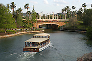 A boat ferries tourists from the Universal Orlando CityWalk to the Royal Pacific Resort in Orlando, Florida.