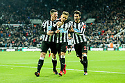 Dwight Gayle (#9) of Newcastle United celebrates Newcastle United's second goal (2-2) with Ciaran Clark (#2) of Newcastle United and Mikel Merino (#23) of Newcastle Unitedduring the Premier League match between Newcastle United and Leicester City at St. James's Park, Newcastle, England on 9 December 2017. Photo by Craig Doyle.