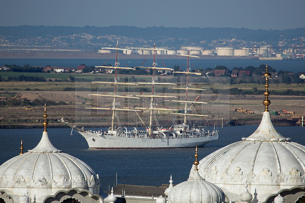 © Licensed to London News Pictures. 03/09/2014. Framed by the turrets of the Sikh temple in Gravesend. The huge tall ship Dar Mlodziezy arrived in London the evening of September 3rd in readiness for this weekend's Royal Greenwich Tall Ships Festival. Reckoned to be the largest tall ship on the Thames for 25 years, the 108-metre-long Class A ship arrived in London shortly before sunset. She will be joined by approximately 50 other ships for the regatta this weekend which is expected to draw over a million people. All of the ships will leave in a Parade of Sail on September 9th. It is the biggest Tall Ships event on the Thames since the Tall Ships Race of 1989. Credit : Rob Powell/LNP