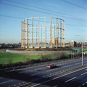 Victorian Gasometer standing next to the North Circular Rd. East Ham, East London. 12.2003. UK