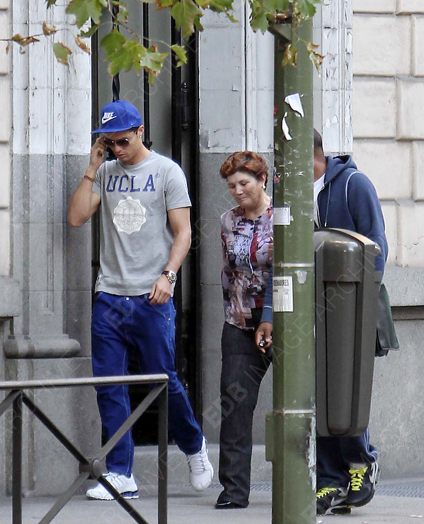22.OCTOBER.2012. MADRID<br /> <br /> CRISTIANO RONALDO VISITS AN ESTHETIC CLINIC IN MADRID, ACCOMPANIED BY HIS MOTHER DOLORES AND A FRIEND.<br /> BEFORE ENTERING THE CLINIC OF CARMEN NAVARRO, ALSO VISITED IN THE PAST BY THE PRINCESS LETIZIA OF SPAIN, CRISTIANO WAS TURNING AROUND TO BE SURE THAT THERE WAS NOT PHOTOGRAPHERS, BEFORE A WOMAN WHO WORKS FOR THE CLINIC WAITED FOR HIM AT THE ENTRANCE. CRSISTIANO WAS THERE FOR TWO AND A HALF HOURS, BEFORE LEAVING AND WAS NOT HAPPY AT BEING PHOTOGRAPHED LEAVING THE CLINIC.<br /> <br /> BYLINE: EDBIMAGEARCHIVE.CO.UK<br /> <br /> *THIS IMAGE IS STRICTLY FOR UK NEWSPAPERS AND MAGAZINES ONLY*<br /> *FOR WORLD WIDE SALES AND WEB USE PLEASE CONTACT EDBIMAGEARCHIVE - 0208 954 5968*
