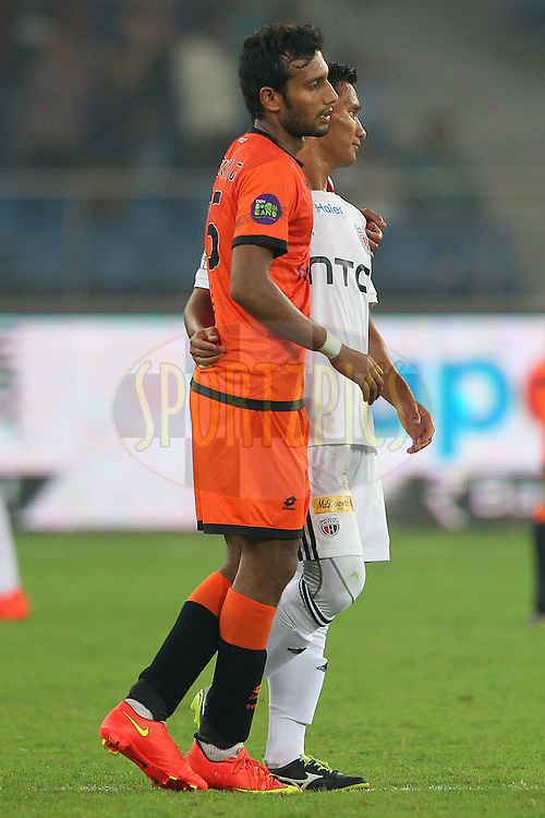Plauyers shake hands after the match during match 16 of the Hero Indian Super League between The Delhi Dynamos FC and NorthEast United FC held at the Jawaharlal Nehru Stadium, Delhi, India on the 29th October 2014.<br /> <br /> Photo by:  Ron Gaunt/ ISL/ SPORTZPICS