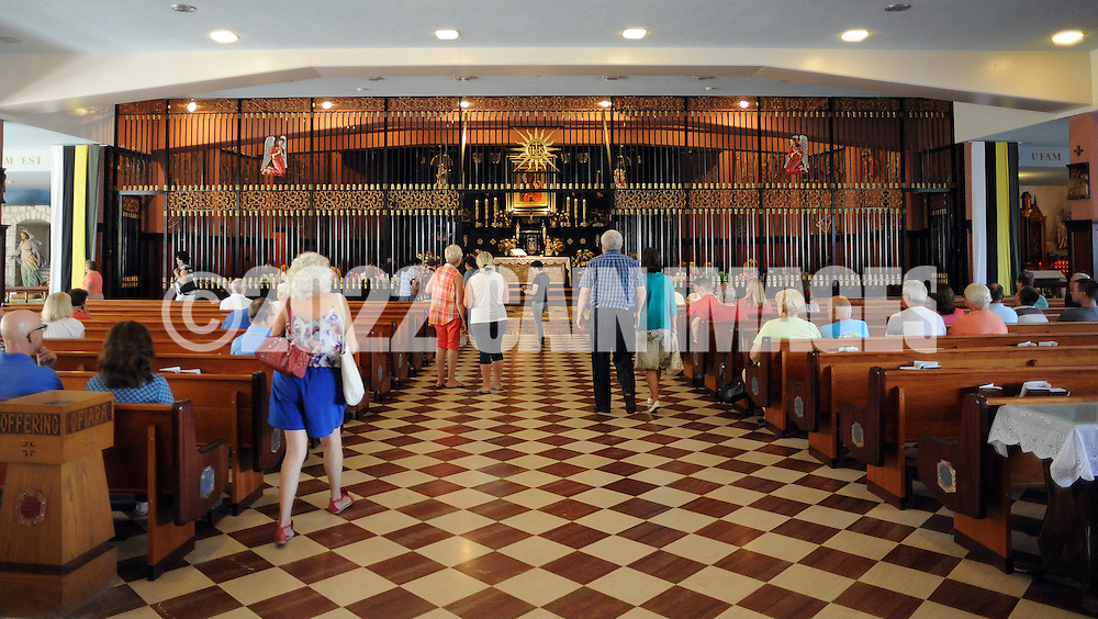 PSHRINE07P<br /> Worshippers arrive for a mass in the lower church during the 50th annual Polish American family festival and country fair at the National Shrine of Our Lady of Czestochowa Sunday September 6, 2015 in Doylestown, Pennsylvania.  (William Thomas Cain/For The Inquirer)