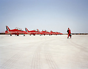 Single pilot of the Red Arrows, Britain's RAF aerobatic team walks out to his Hawk aircraft before a display flight to Jordan.
