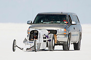 "Best cars-people-atmosphere-photos of 2009 Bonneville Speed Week-  Don Wheeler, owner and driver of the ""Salt Lick"" Lakester from  Parker, Colorado, is pushed back to pit row following a run, August 9, 2009.  Photo by Colin E. Braley"
