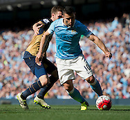 Sergio Aguero of Manchester City (right) gets past Hector Bellerin of Arsenal during the Barclays Premier League match at the Etihad Stadium, Manchester<br /> Picture by Russell Hart/Focus Images Ltd 07791 688 420<br /> 08/05/2016