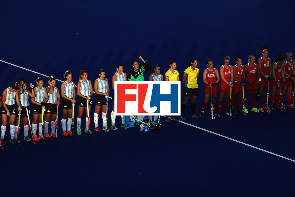 RIO DE JANEIRO, BRAZIL - AUGUST 06:  Team USA and Team Argentina line up prior to a Women's Pool B match between the United States and Argentina on Day 1 of the Rio 2016 Olympic Games at the Olympic Hockey Centre on August 6, 2016 in Rio de Janeiro, Brazil.  (Photo by Sean M. Haffey/Getty Images)