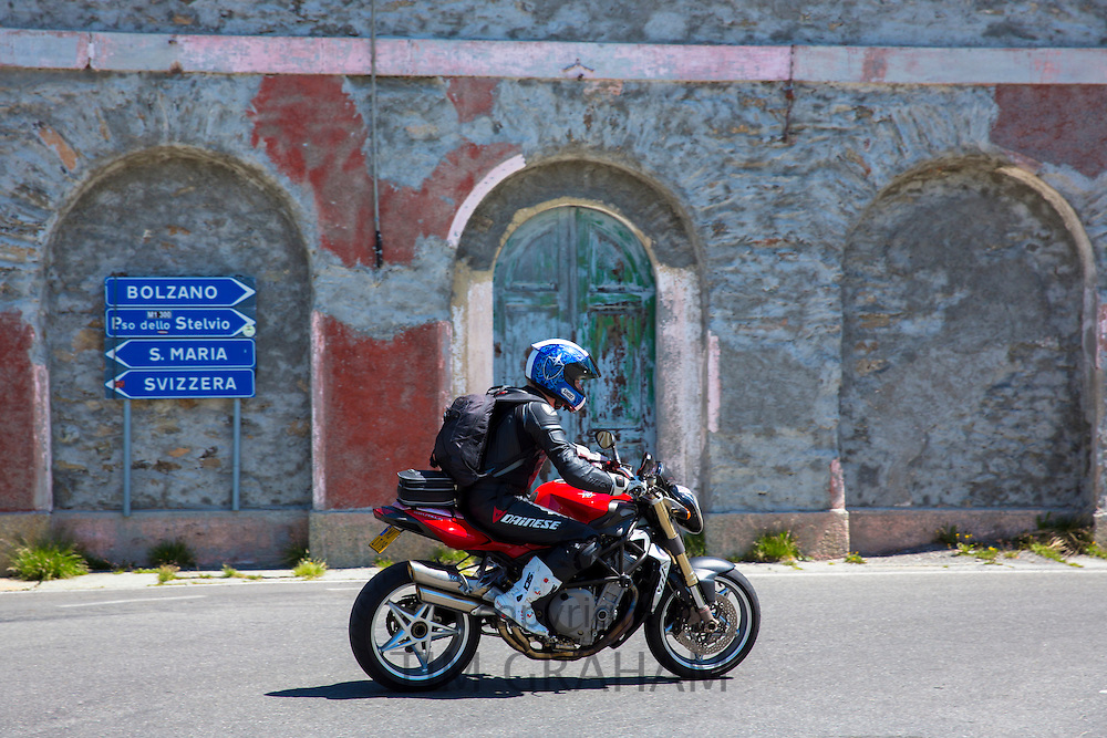 Motorcyclist on MV Agusta Brutale motorbike drives The Stelvio Pass, Passo dello Stelvio, Stilfser Joch, to Bormio, Italy