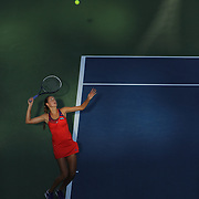 Bojana Jovanovski, Serbia, in action in the late afternoon light against Eugenie Bouchard, Canada, during the first round of the Connecticut Open at the Connecticut Tennis Center at Yale, New Haven, Connecticut, USA. 18th August 2014. Photo Tim Clayton