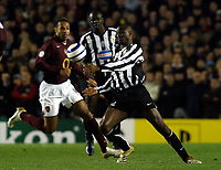 Photo: Chris Ratcliffe.<br /> Arsenal v Juventus. UEFA Champions League. Quarter-Finals. 28/03/2006.<br /> Patrick Vieira of Juventus is paid close attention by Thierry Henry