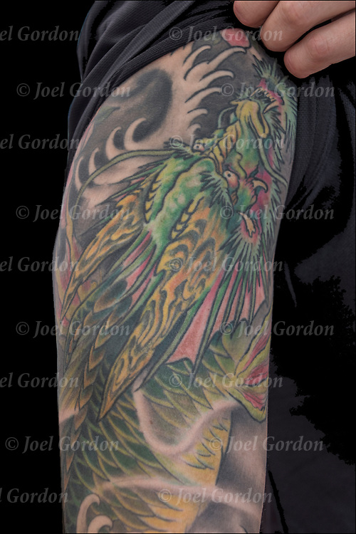 Dragon tattoo sleeve on his shoulder and arm.<br /> <br /> Body art or tattoos has entered the mainstream it is no longer considered a weird kind of subculture.<br /> <br /> &quot;According to a 2006 Pew survey, 40% of Americans between the ages of 26 and 40 have been tattooed&quot;.