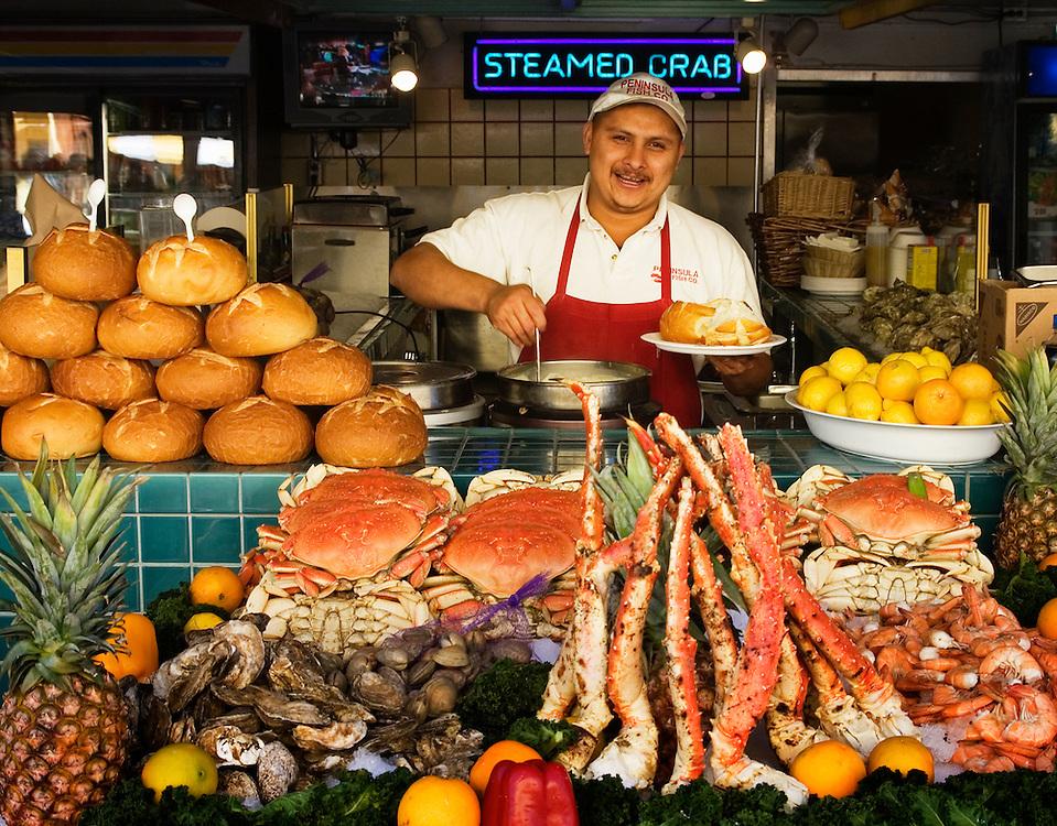 Antonio Miguel of Peninsula Fish Market at Fisherman's Wharf, Monterey, California.