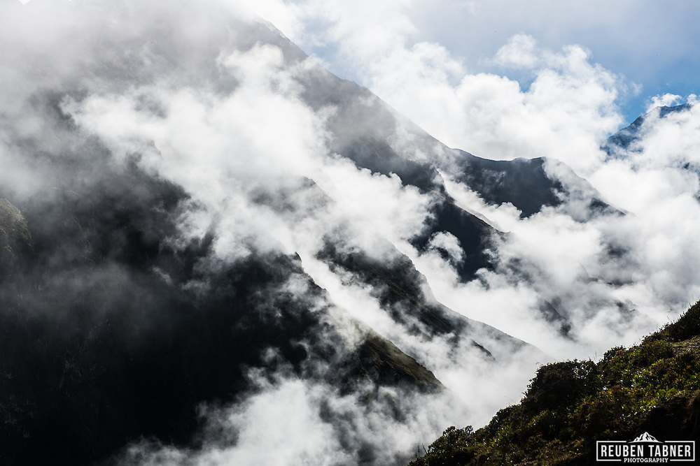 The mountains breath, as cloud rises from the gullies, Gokyo Valley, Nepal.