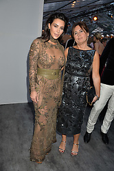 Left to right, KIM KARDASHIAN WEST and ALEXANDRA SHULMAN at British Vogue's Centenary Gala Dinner in Kensington Gardens, London on 23rd May 2016.