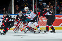 KELOWNA, CANADA - MARCH 14:  Nolan Foote #29 of the Kelowna Rockets is cross checked by Austin Crossley #6 as Jared Bethune #21 misses a block shot on Taylor Gauthier #35 of the Prince George Cougars on March 14, 2018 at Prospera Place in Kelowna, British Columbia, Canada.  (Photo by Marissa Baecker/Shoot the Breeze)  *** Local Caption ***