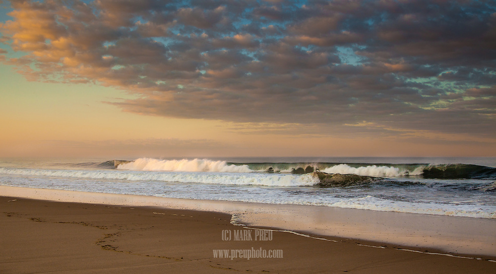 The last rays of sun touch part of a breaking wave at Cahoon Hollow Beach in Wellfleet.