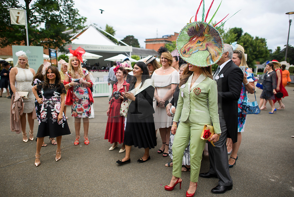 © Licensed to London News Pictures. 19/06/2018. London, UK. Racegoers wait to have their photograph taken at day one of Royal Ascot at Ascot racecourse in Berkshire, on June 19, 2018. The 5 day showcase event, which is one of the highlights of the racing calendar, has been held at the famous Berkshire course since 1711 and tradition is a hallmark of the meeting. Top hats and tails remain compulsory in parts of the course. Photo credit: Ben Cawthra/LNP
