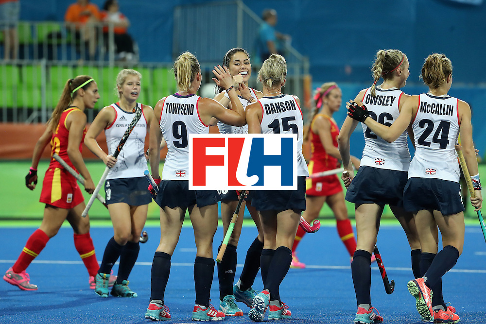RIO DE JANEIRO, BRAZIL - AUGUST 15:  Sam Quek #13, Alex Danson #15 and Susannah Townsend #9 of Great Britain celebrate after Lily Owsley #26 (second from right) scored a first half goal against Spain during the quarter final hockey game on Day 10 of the Rio 2016 Olympic Games at the Olympic Hockey Centre on August 15, 2016 in Rio de Janeiro, Brazil.  (Photo by Christian Petersen/Getty Images)