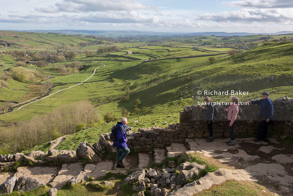 Walkers near Malham Cove in the Yorkshire Dales National Park, on 12th April 2017, in Malham, Yorkshire, England.