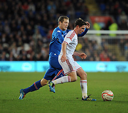Joe Allen of Wales (Liverpool) is challenged by Bjorn Daniel Sverrisson (Viking FK) of Iceland  - Photo mandatory by-line: Dougie Allward/JMP - Tel: Mobile: 07966 386802 03/03/2014 -