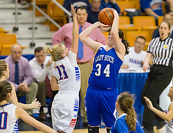 Buckhannon Upshur forward Makayla Reynolds (34) shoots over Morgantown guard Liv Seggie (11) during a first round game at the Charleston Civic Center.