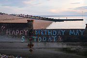 A seascape of calm waters of the Thames Estuary and a Happy Birthday message to a five year-old called May has been chalked on a coastal groyne, on 18th July 2020, in Whitstable, Kent, England.