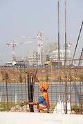 A worker with helmet working at the building site of Expo 2015, Rho, June 2014. &copy; Carlo Cerchioli<br /> <br /> Un operaio, con caschetto al lavoro nel cantiere di Expo 2015, Rho, giugno 2014.