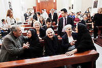 "PERDASDEFOGU, SARDINIA, ITALY - 30 JUNE 2013: Claudina Melis (center) sits in the front row of St. Peter's church where a mass celebrating her 100th birthday is about to start, in Perdasdefogu, Italy, on June 30th 2013. On the far left, her son Fabio greets his aunt Consolata (Claudina's sister) of 106 years old.<br /> <br /> Last year, the Melis family entered the Guinness Book of World Records for having the highest combined age of any nine living siblings on earth — today more than 825 years. The youngest sibling, Mafalda – the ""little one"" – is 79 years old.<br /> <br /> The Melis siblings were all born in Perdasdefogu to Francesco Melis and Eleonora Mameli, who had a general store. Consolata, 106, is the oldest, then Claudia, 100; Maria, 98; Antonino, 94; Concetta, 92; Adolfo, 90; Vitalio, 87; Fida Vitalia, 81; and Mafalda, the baby at 79. Their descendants now account for about a third of the village."