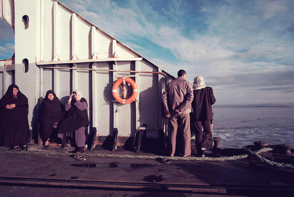 Passengers stand on the quarterdeck of the ferry awaiting embarkment at Tatvan Wharf on Lake Van, Van province, Turkey during the the 3 day journey from Tehran to Damascus on 15th Nov, 2007.