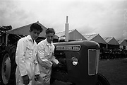 06/05/1965<br /> 05/06/1965<br /> 06 May 1965<br /> Final of the 4th Annual David Brown Tractor and Implement Maintenance Competition held at the RDS Spring Show, Ballsbridge, Dublin. John O'Connell, (right) of Knocksaharn, Kilnamartyra, Macroom, Co. Cork assisted by his helper, John Collins of Shandangan, Killinarbrish, Co. Cork the Cork team, representing Munster,who came third in the competition.