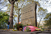 Flowers laid to commemorate poet and artist WIlliam Blake (1757 ? 1827) who is buried elsewhere in Bunhill Fields cemetery, City of London