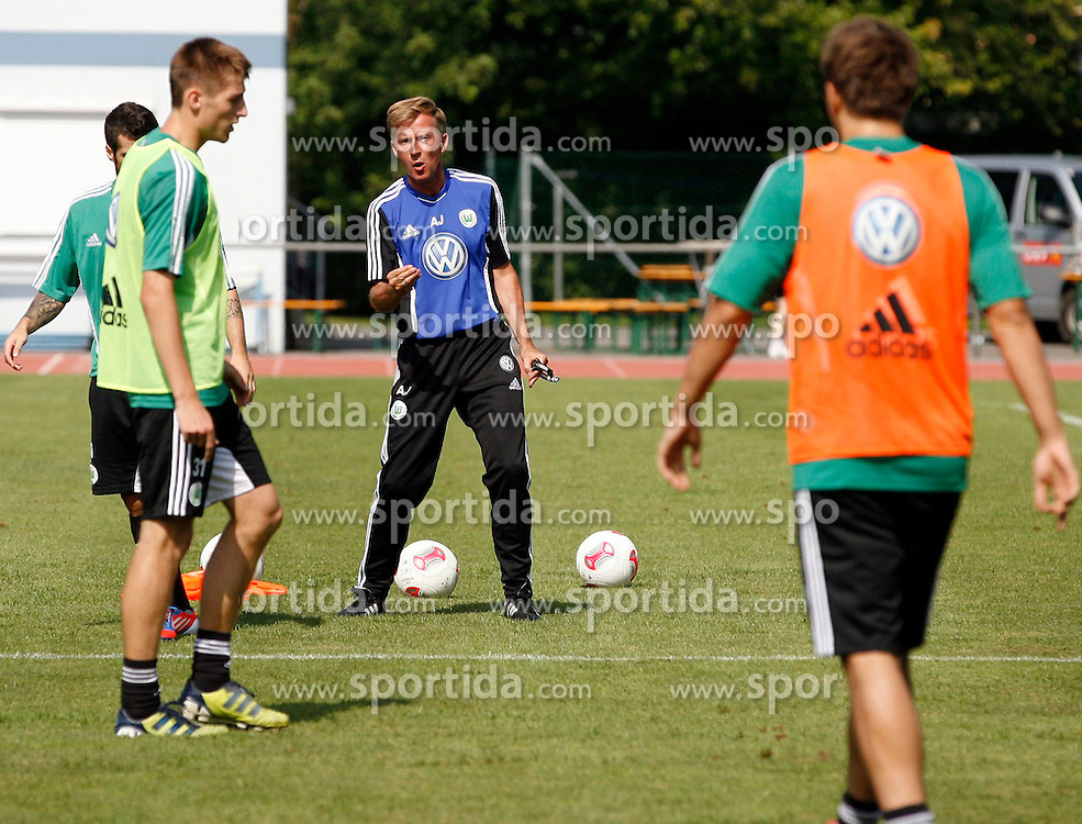 06.08.2012, Stadion Lind, Villach, AUT, VfL Wolfsburg Trainingslager, im Bild Andries Jonker (Co-Trainer Wolfsburg) wahrend einer Trainingseinheit // during the training session from Vfl Wolfsburg on 2012/08/06. EXPA Pictures © 2012, PhotoCredit: EXPA/ Oskar Hoeher.