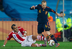 Claudio Morel of Paraguay vs Andres Iniesta of Spain during the  2010 FIFA World Cup South Africa Quarter Finals football match between Paraguay and Spain on July 03, 2010 at Ellis Park Stadium in Johannesburg. (Photo by Vid Ponikvar / Sportida)