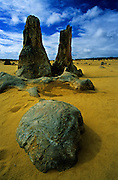 A rock and two pinnacles on the strange landscape of Pinnacles Desert, in Nambung National Park, on Western Australia