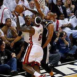 Jun 6, 2013; Miami, FL, USA; Miami Heat small forward LeBron James (6) lays the ball up defended by San Antonio Spurs power forward Tim Duncan (21) in the first quarter during game one of the 2013 NBA Finals at the American Airlines Arena. Mandatory Credit: Derick E. Hingle-USA TODAY Sports