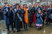 Sadiq Khan and Bianca - Jagger and other calp at the end - #March4Women 2018, a march and rally in London to celebrate International Women's Day and 100 years since the first women in the UK gained the right to vote.  Organised by Care International the march stated at Old Palace Yard and ended in a rally in Trafalgar Square.