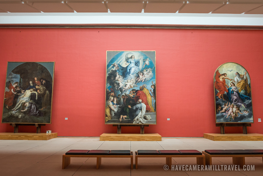 Paintings by Peter Paul Rubens (1577-1640) in a dedicated room at the Royal Museums of Fine Arts in Belgium (in French, Musées royaux des Beaux-Arts de Belgique). The painting at left is titled Peita Avec Saint Francois, at center L'Assomption de la Vierge, and at right Le Couronnement de la Vierge. The museum is one of the most famous museums in Belgium. The complex consists of several museums, including Ancient Art Museum (XV - XVII century), the Modern Art Museum (XIX ­ XX century), the Wiertz Museum, the Meunier Museum and the Museé Magritte Museum.