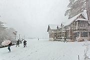 People strugling through the snow storm at the Ridge, Shimla, Himachal Pradesh, India