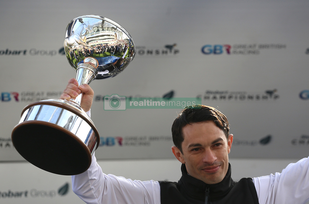 Silvestre de Silva with the Champion Jockey trophy presented during Qipco British Champions Day at Ascot Racecourse.