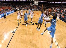 Virginia guard Sean Singletary (44) shoots over North Carolina guard Wayne Ellington (22) and guard/forward Marcus Ginyard (1).  The Virginia Cavaliers men's basketball team fell to the #3 ranked North Carolina Tar Heels 75-74 at the John Paul Jones Arena in Charlottesville, VA on February 12, 2008.