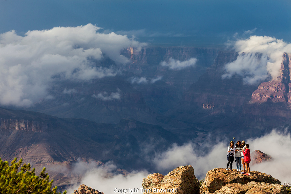 "Tourists making ""selfies"" of themselves from Desert View of the gathering storm over the Canyon"