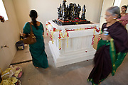 18 MAY 2008 -- MARICOPA, AZ: Women pray as they process around a deity which represents the solar system in a Hindu temple in Maricopa, AZ, Sunday. More than 3,000 Hindus from Arizona, southern California and New Mexico came to Maricopa, a small town in the desert about 50 miles south of Phoenix, for the dedication of the Maha Ganapati Temple of Arizona. It is the first Hindu temple in Arizona designed according to ancient South Indian Hindu architectural guides. Craftsmen from India came to Maricopa to complete the interior details of the temple. The dedication ceremonies lasted three days.   Photo by Jack Kurtz / ZUMA Press