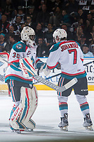 KELOWNA, CANADA - MARCH 24: Michael Herringer #30 and Lucas Johansen #7 of the Kelowna Rockets celebrate a goal against the Kamloops Blazers on March 24, 2017 at Prospera Place in Kelowna, British Columbia, Canada.  (Photo by Marissa Baecker/Shoot the Breeze)  *** Local Caption ***