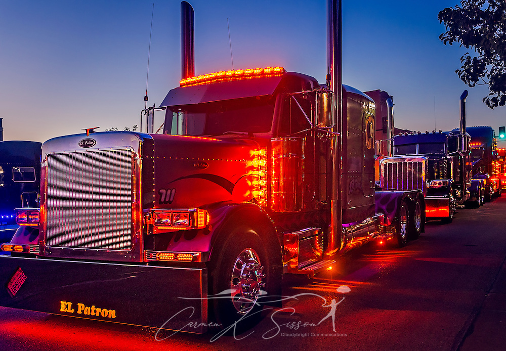 "Ray Rodriguez's ""El Patron,"" a 2000 Peterbilt 379, leads the way during the light show contest during the 34th annual Shell Rotella SuperRigs. SuperRigs, organized by Shell Oil Company, is an annual beauty contest for working trucks. Approximately 89 trucks entered this year's competition. (Photo by Carmen K. Sisson/Cloudybright)"