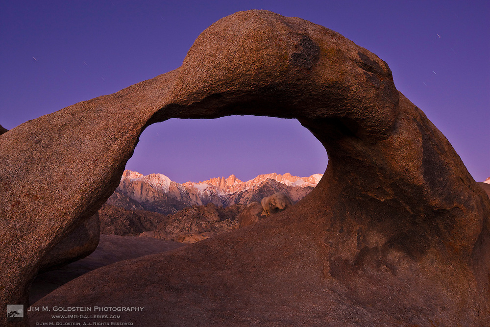 First light on Mount Whitney as seen through Mobius Arch in the Alabama Hills