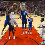 03 February 2018: The San Diego State Aztecs look to rebound after a couple losses against Air Force Saturday night. San Diego State Aztecs forward Malik Pope (21) goes up for a lay up while being defended by Air Force Falcons forward Lavelle Scottie (12) and  guard Trevor Lyons (20) for a rebound in the first half. The Aztecs beat the Falcons 81-50 at Viejas Arena.<br /> More game action at www.sdsuaztecphotos.com