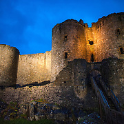 The main gatehouse at Harlech Castle in Harlech, Gwynedd, on the northwest coast of Wales next to the Irish Sea. The castle was built by Edward I in the closing decades of the 13th century as one of several castles designed to consolidate his conquest of Wales.