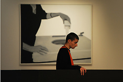 © Licensed to London News Pictures. 21/10/2013. London, UK. A man stands in front of Machine On Laver by Peter Stampfli at The Pop Art Design Exhibition preview at The Barbican Centre. Photo credit : David Mirzoeff/LNP