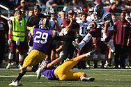 University of Redlands running back Camryn Davis jumps over a Cal Lutheran defense lineman in William Rolland Stadium at Cal Lutheran University in Thousand Oaks, Calif. on Nov. 11, 2017.